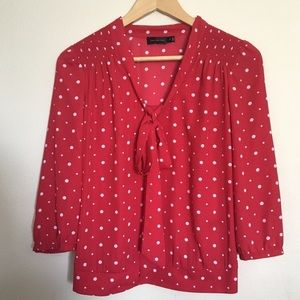 The Limited Red and white polka dot bow tie blouse